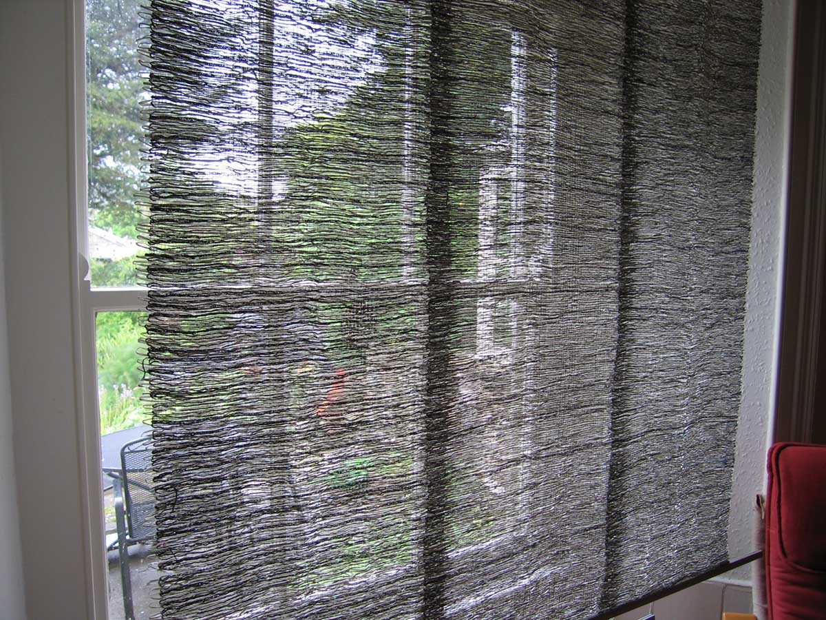 lauras loom Panels in Window